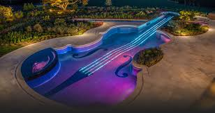 outstanding outdoor pool design with violin shaped pool with artistic lighting fixture also stone pool artistic lighting and designs