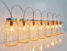 mason jar lighting diy 2014 diy outdoor lightings mason jar lamp banner style lighting fixture with alternating length wagon wheel mason jar