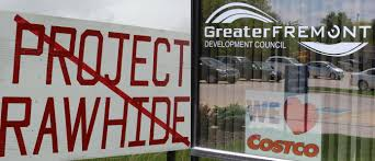 critics concerned chicken project will damage water but company signs for and against a proposed costco chicken processing plant nick project rawhide posted in the town of fremont in northeast nebraska