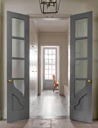 long and narrow home office with gray bi fold doors bi fold doors home office