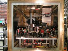 LinTrap   Quantum Optics and Spectroscopy LinTrap   Quantum Optics and Spectroscopy A closer look at the quantum computing setup showing a box of mu metal for magnetic shielding  inside the vacuum vessel housing the ion trap and laser beam