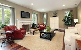 beautiful brown living room with large brown area rug also red and white seats plus black beautiful brown living room