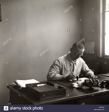 people professions office clerk working at the desk s stock photo people professions office clerk working at the desk 1930s