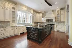 beautiful white kitchen cabinets: beautiful white cabinet kitchen with large dark wood island