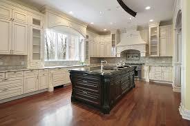 beautiful white kitchen cabinets: beautiful white cabinet kitchen with large dark wood island