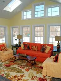 brilliant country living room ideas with red sofa also beige arm chairs plus table brilliant red living room furniture
