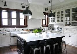traditional kitchen idea in chicago with glass front cabinets stainless steel appliances a farmhouse sink white cabinets marble countertops white backsplash cabinet lighting backsplash home