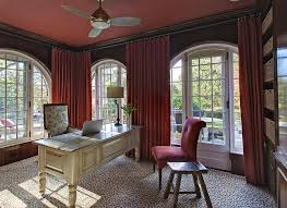 view in gallery even the ceiling and drapes embrace a bold splash of color in this home office cheerful home office rug