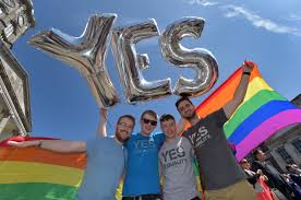 says yes to legalizing gay marriage in historic supporters in favor of same sex marriage pose for a photograph as thousands gather in
