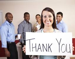 sample employee thank you letters for the workplace employee holding a than you sign diverse employees behind her
