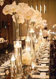 day orchid decor: tall orchid wedding centerpiece idea via a day of bliss photographya http