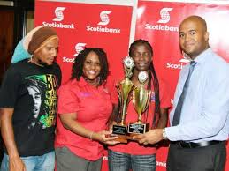 of the Scotiabank sponsored University of the West Indies Entrepreneur Builder Club  graciously receives her awards writing the best business plan in