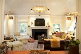 upholstered pad family room contemporary amazing ideas with vaulted ceiling potted plant amazing family room lighting