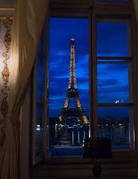 u s department of defense photo essay an open window shows a night view of the eiffel tower in paris sept