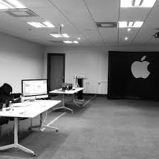 a rather sparsely populated office space apple office