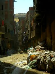 inside cairo s garbage city slums waste management and they work informally as cairo s most important labor force of garbage collectors sorters and recyclers