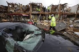 workers search for survivors of texas plant explosion com a smashed car sits in front of an apartment complex destroyed by an explosion at a