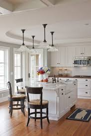ideas for lighting over kitchen island with ceramic farmhouse sink and oil rubbed bronze bridge faucet breathtaking modern kitchen lighting options