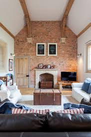 exposed brick wall living room farmhouse remodeling ideas with white sofa coffee table trunk brick living room furniture