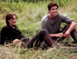 the world of hunger games magazine scans more stills from the katniss and her hunting partner bestfriend gale at the meadows