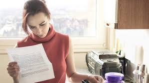 what was no child left behind nclb  parent standing in kitchen reading a letter