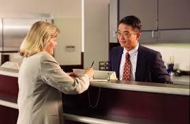 salary and benefits w writing check at bank counter