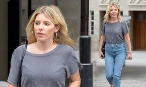 Mollie King rocks a <b>casual</b> grey T-shirt and high-<b>waisted jeans</b> ...