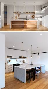 kitchen island integrated handles arthena varenna: in this mostly white kitchen the island has exposed storage and an overhang makes it