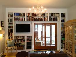astounding home library decorating ideas with built in bookshelves feat vintage chandelier over brown couch tricks built home library