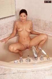 Porn star Zafira fingering pussy in the bathroom Porn Pics