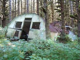 Seacoast Defenses of Kodiak ially collapsed Quonset hut in the small housing area