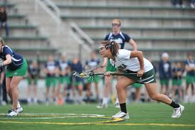 loyola magazine administrators staff jen adams head coach for greyhounds women lacrosse took a young team including players such as freshman attacker hannah schmitt shown here to the team s