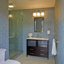 light blue coastal bathroom with glass shower ample shower lighting