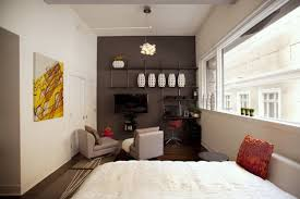 modern studio apartment design bedroom decorating with bed with mattress and pillows also headboard and sofa apartment studio furniture