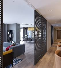 grey themed interiors decor with modern style slats room divider modern design apartment with wood flooring amazing light wood