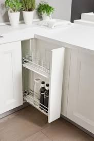 rolling corner kitchen storage unit offering functional and decorative cabinet hardware for  years