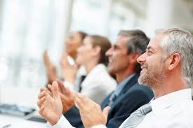 pensions minister appoints older workers champion group of happy business people clapping their hands