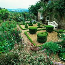 Small Picture A formal gravel garden with mature box topiary edged in English