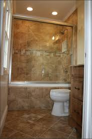 bathroom shower tile design color combinations: cream shower tile designs used in small bathroom with wooden vanity and white toilet