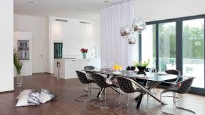 metal dining room chairs chrome: metal dining chair big standing glass windows ball glass pendant lamp stainless steel dining chair frames black glass dining table brown laminated wooden flooring long white fabric curtain