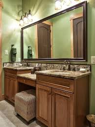 traditional green bathroom with light wood vanity hgtv wooden bathroom vanity light bathroom vanity lighting bathroom traditional