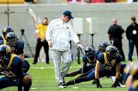 don t hate the player are college athletes working for a degree ap photo marcio jose sanchez coach tedford leading warm ups during the 2012