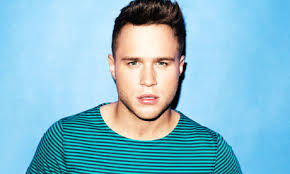When thinking of great motivational music – Eye of the Tiger, Lose Yourself – Olly Murs isn't the first artist that springs to mind. - Olly-Murs-007