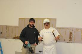 kitchen renovations begin at the dew drop inn adam gollat of gollat contracting and julio chiodo ddi soup kitchen manager pause for