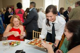 a day in the life of a baton rouge caterer baton rouge business ruffino s catering server hanna lee delivers appetizers to wedding guest during a recent wedding at ruffino s catering at de la ronde hall