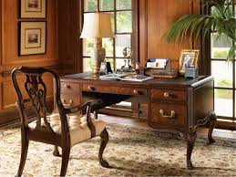 decoration artistic carving on solid maple desk and classic wooden armchair on traditional brown carpet artistic luxury home office furniture home