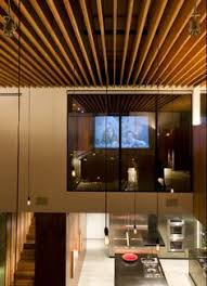 custom lake house design by della valle bernheimer artreehouse wood beam in basement office design