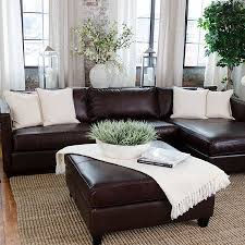 i really like the placement of the couch against the window wall with the flower arrangement brown furniture living room ideas