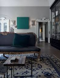 blue living room with blue and white oriental rug antique gold furniture velvet pillow blue and white furniture