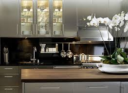 black and stainless kitchen suzie carlyle designs stainless steel kitchen cabinets with glossy black countertops amp